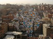 Tunisian-French artist creates a mural across 50 buildings in Cairo without the government noticing