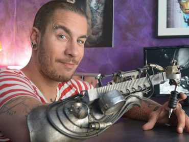 This guy has the worlds first tattoo machine prosthesis